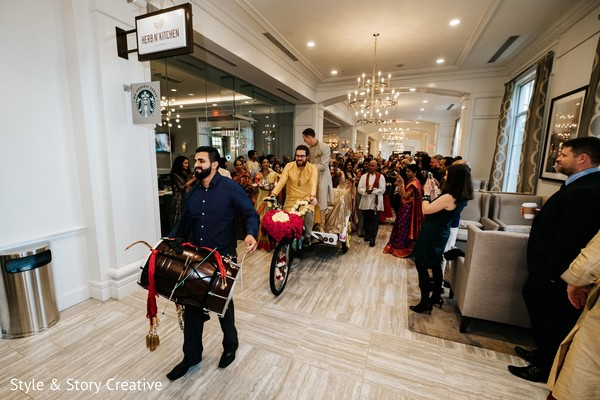 Indian groom following the dhol player.