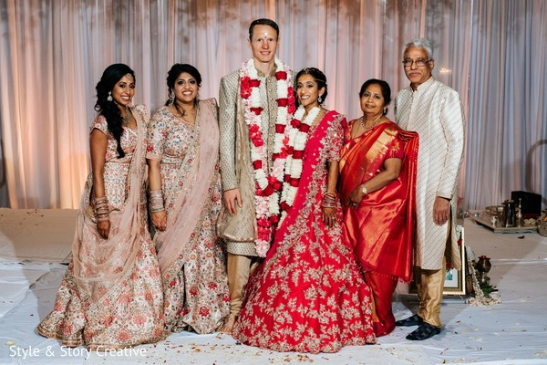 Indain couple posing with relatives.