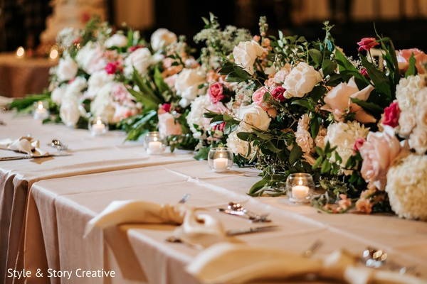 White and pink Indian wedding rectangle table flower decoration.