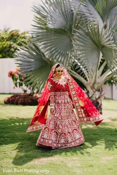 Maharani in her red and golden lehenga.