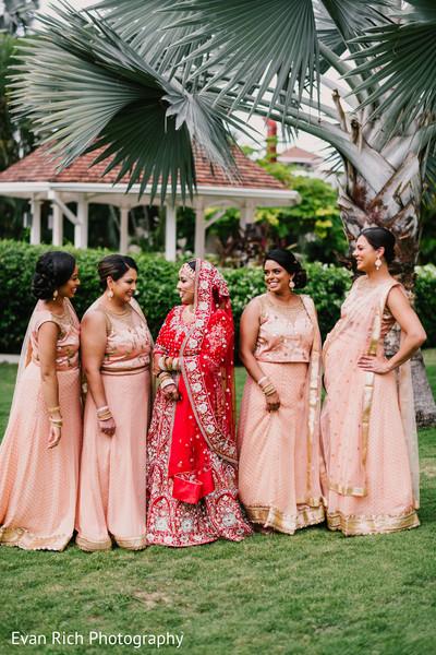 Maharani in her red lehenga and bridesmaids.