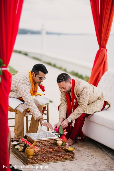 Raja putting flowers to Agni.