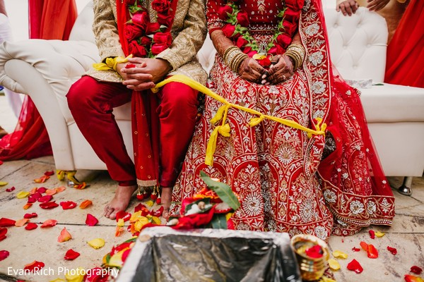 Indian bride and groom tying the knot.