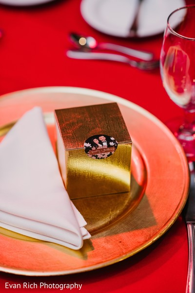 Golden Indian wedding favor with a personalized sticker.