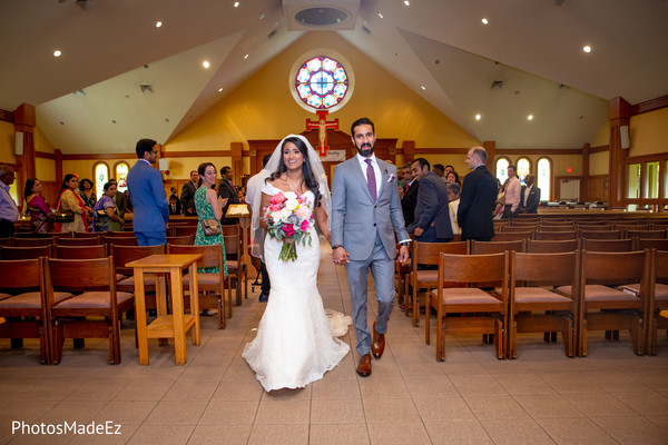 Indian couple leaving the Christian wedding ceremony