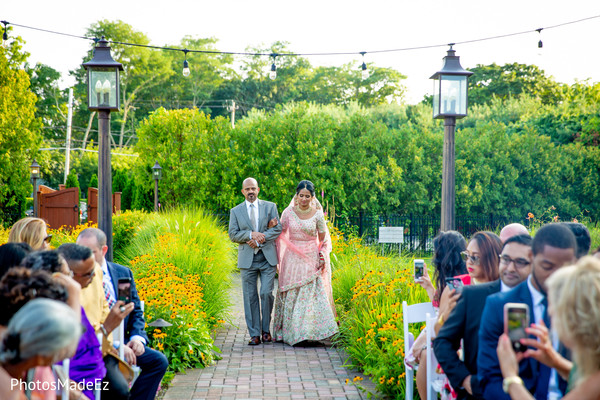 Ravishing Indian bride making her entrance to the wedding ceremony