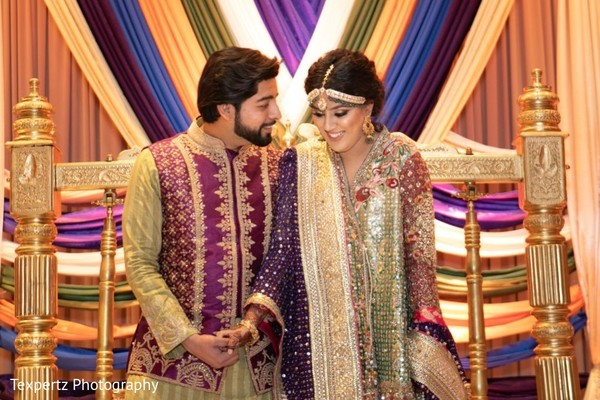 Sweet capture of Indian bride and groom at their Mehndi party