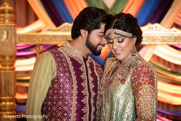 Bride and Groom posing at their Mehndi party