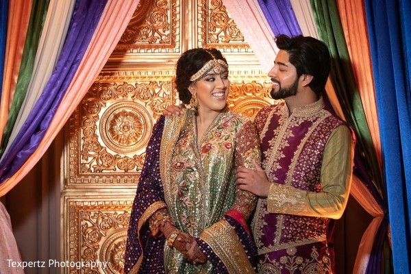 Sweet capture of Indian bride and groom at their Mehndi