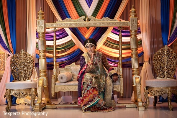 Indian bride posing for a photoshoot at her Mehndi