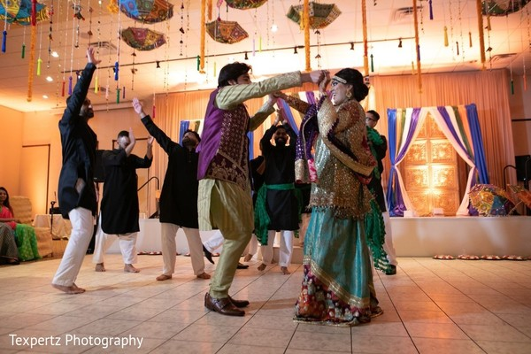 Indian lovebirds dancing at their Mehndi