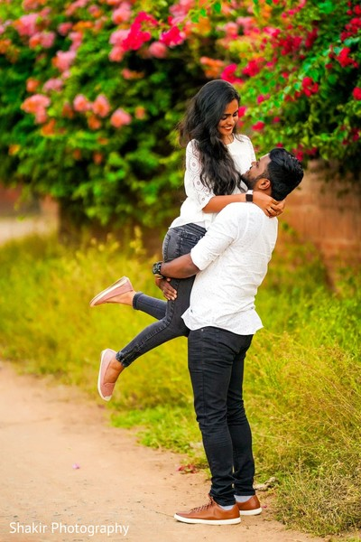 Indian lovebirds having fun at their outdoor photoshoot