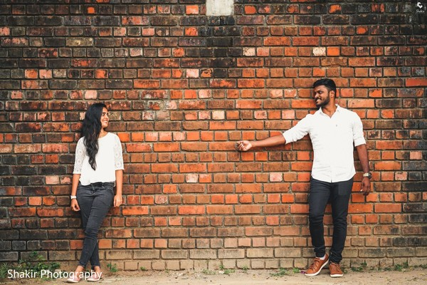 Adorable capture of Indian bride and groom having fun at photo session