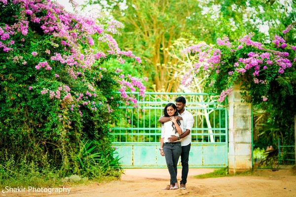 Charming captured of bride and groom surrouned by greenery