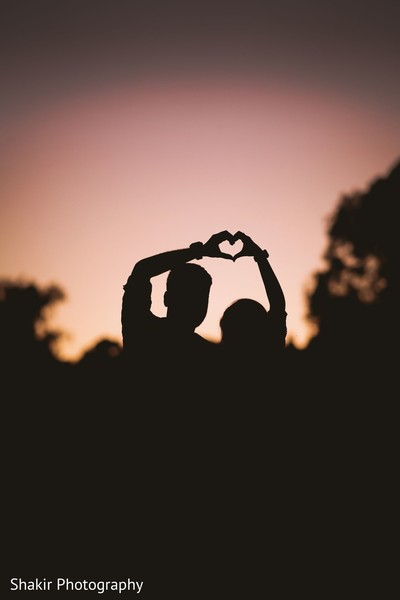 Indian lovebirds having fun and making romantic silhouettes at sunset