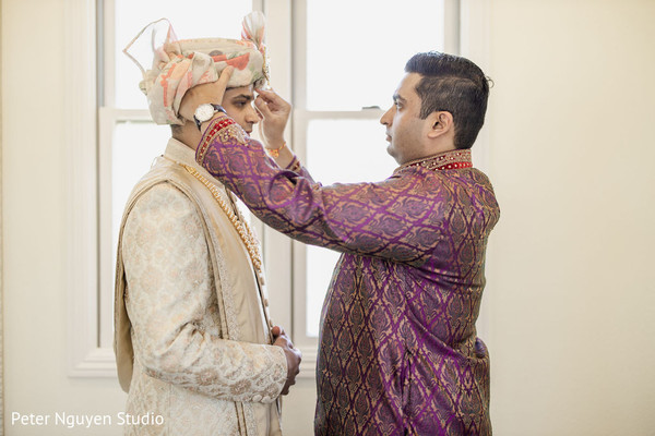 Indian groom getting ready for wedding ceremony.