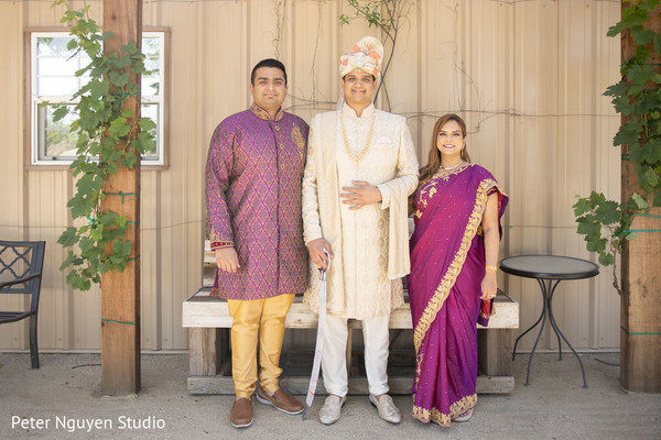 Elegant Indian groom with family members