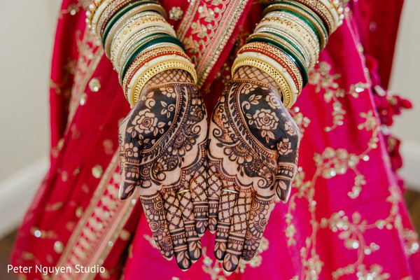 Elegant Indian bride bangles and Mehndi art