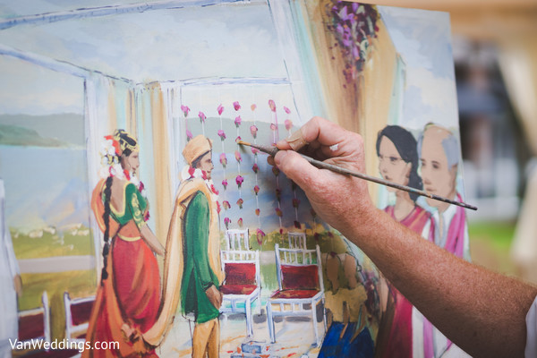 Fantastic shot of live painter immortalizing the wedding ceremony.
