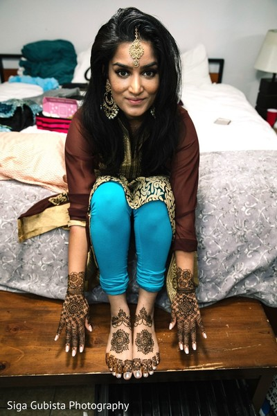 Indian bride showcasing her fabulous Mehndi art