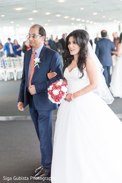 Indian bride walking down the alter with her father