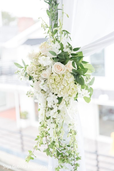 Gorgeous floral decor for Christian wedding ceremony.