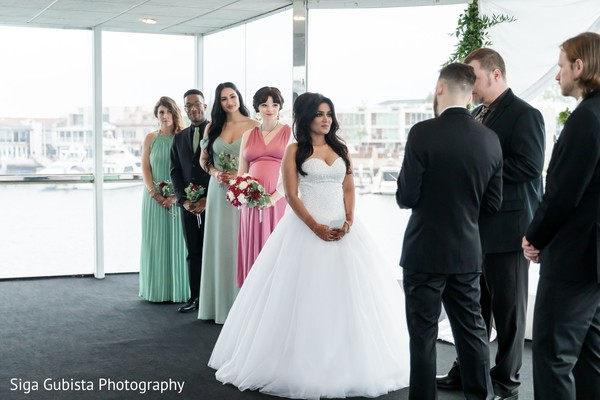 Sweet shot of bride and groom during their vows.