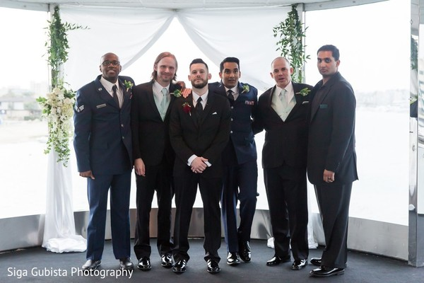 Groom and groomsmen posing for photoshoot during the wedding ceremony