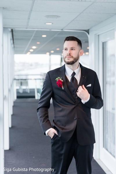 Elegant groom posing for photoshoot before the wedding ceremony