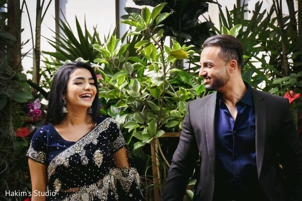 Joyful Indian bride and groom at engagement photoshoot.