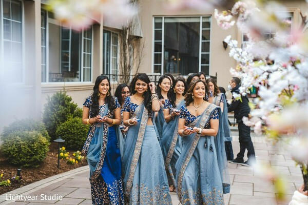 Indian bridesmaids getting ready for the ceremony.