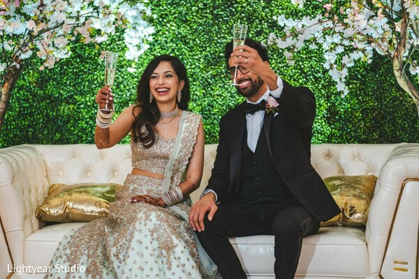 Indian couple having a toast at the Indian wedding reception.