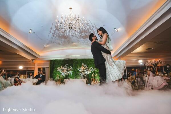 Indian couple at reception dancefloor.