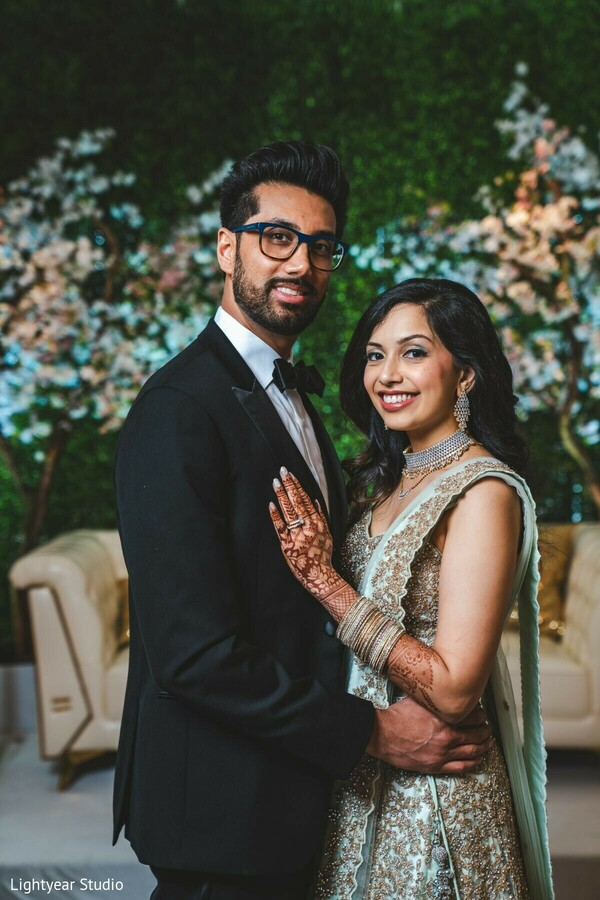 Maharani and raja posing at the wedding reception venue.