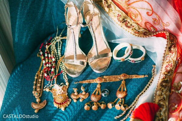 Maharanis wedding jewelry and golden shoes.