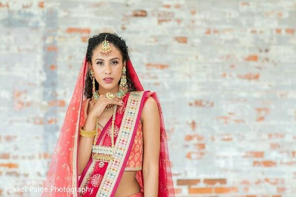 Indian bride on her Coral color sari.