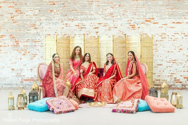 Maharani posing between her bridesmaids.