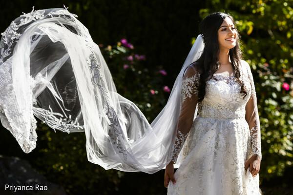 Maharani possing with white wedding dress.
