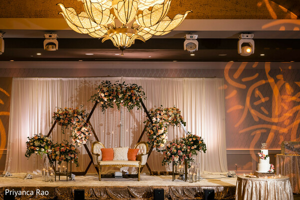 Orange and white colors in Indian wedding reception decoration.