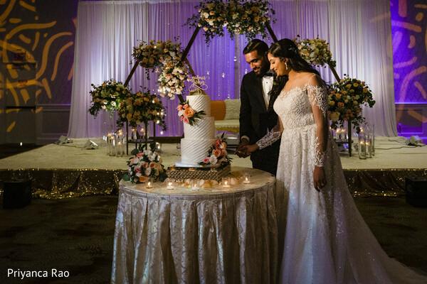 Indian couple cutting cake photography.