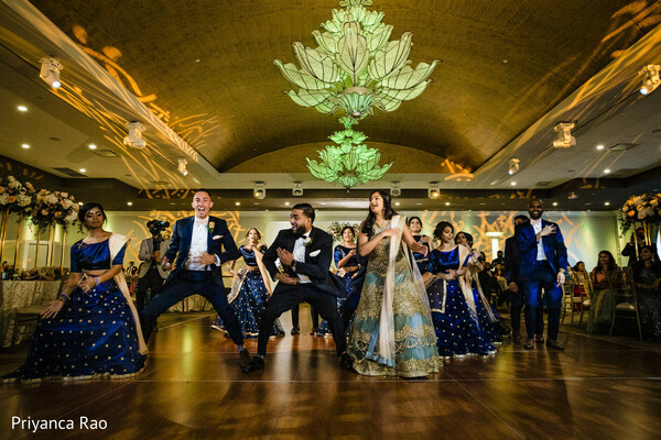 Indian couple at wedding reception dance.