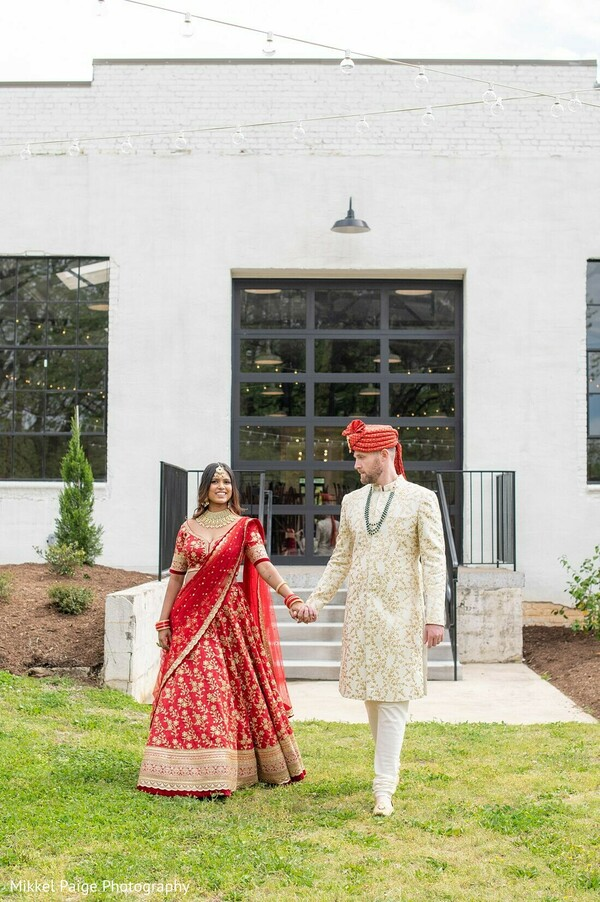 Indian couple holding hands capture.