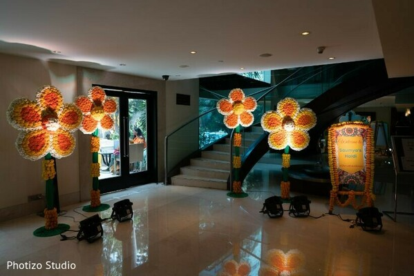 Orange, yellow, and white flowers for haldy party decoration.