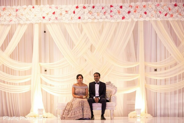 Indian couple at the wedding reception stage.