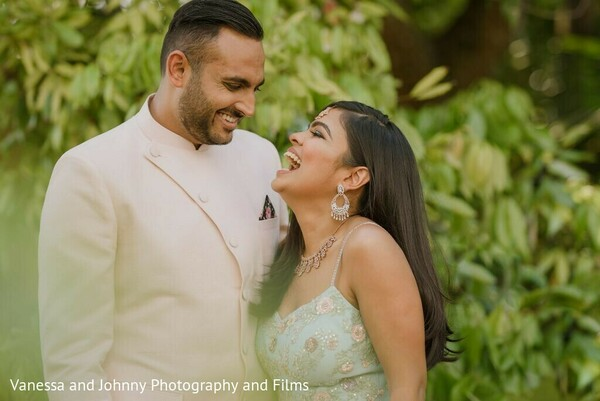 Indian couple posing outdoors at their engagement celebration.