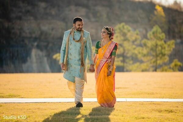 Indian couple walking hand in hand capture.