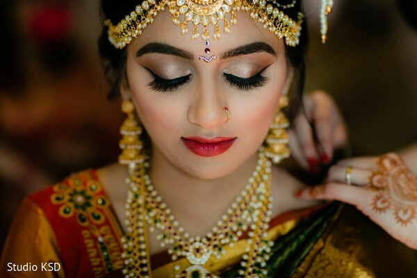 Indian bride with her ceremony jewelry and makeup.