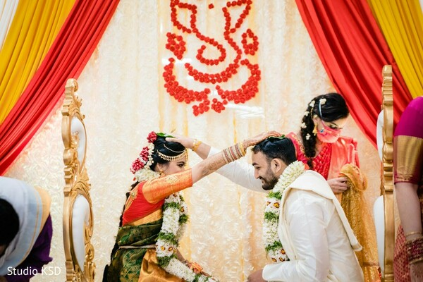 Indian bride and groom at wedding ceremony ritual.