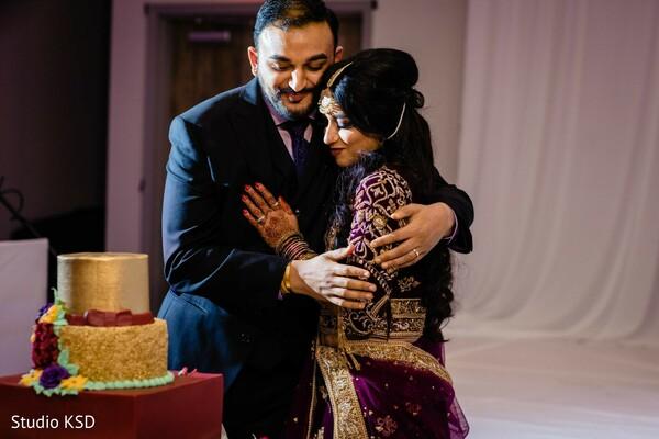 Indian wedding cutting cake moment.