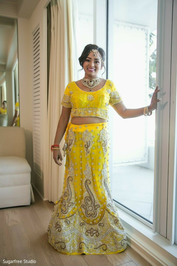 Indian bride wearing her yellow lehenga.